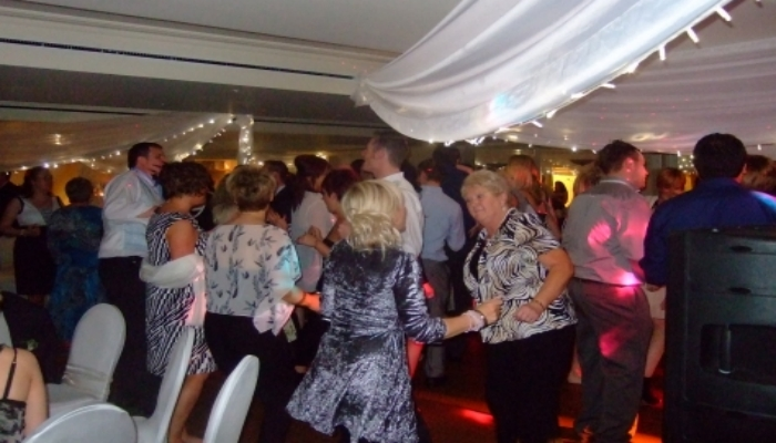 A full dance floor at a wedding reception
