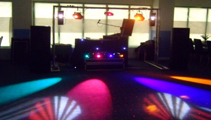 Rig with lights playing on the dance floor